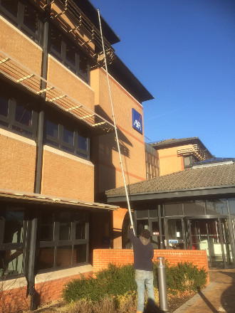 Gutter cleaning at a commercial office block in Reigate